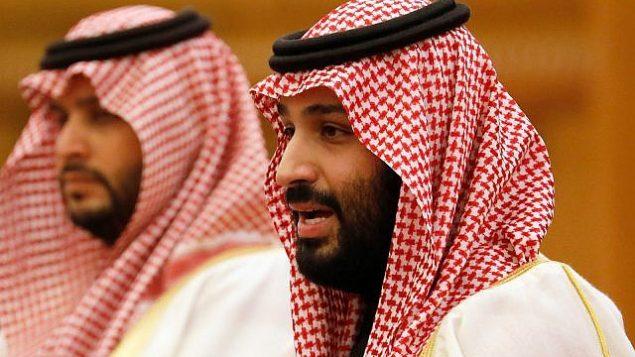 تصویر: «محمد بن سلمان» ولیعهد عربستان سعودی، راست، حین گفتگو در دیداری در پکن، چین، ۲۲ فوریه ۲۰۱۹.  (How Hwee Young/Pool Photo via AP, File)