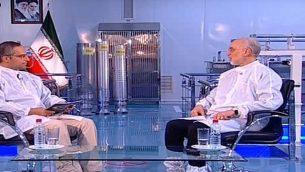 تصویر: عکس ویدئویی از علی اکبر صالحی، رئیس سازمان انرژی اتمی ایران، راست، و سه سنتریفیوژ غنی سازی اورانیوم ساخت ایران در پس-زمینه. (YouTube)