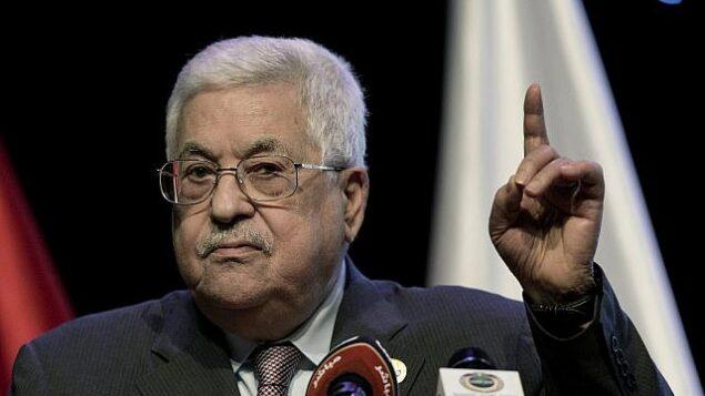 تصویر: محمود عباس رئیس تشکیلات فلسطینی حین سخنرانی در چهارمین نشست انجمن ملی چهارمین انقلاب صنعتی در شب گشایش مراسم در رام الله، کرانه باختری، ۹ سپتامبر ۲۰۱۹. (Nasser Nasser/AP)