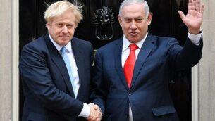 تصویر: بوریس جانسون، نخست وزیر بریتانیا، چپ، حین استقبال از بنیامین نتانیاهو نخست وزیردر ساختمان شماره ۱۰ خیابان داونینگ، مرکز لندن، ۵ سپتامبر ۲۰۱۹. (DANIEL LEAL-OLIVAS / AFP)