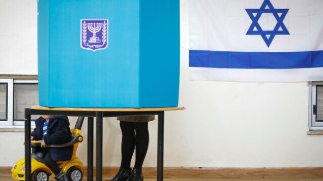 People cast their ballot at a voting station in Jerusalem, during the Knesset Elections, on March 2, 2020. Photo by Olivier Fitoussi/Flash90 *** Local Caption *** מצביע בחירות כנסת הצבעה קלפי