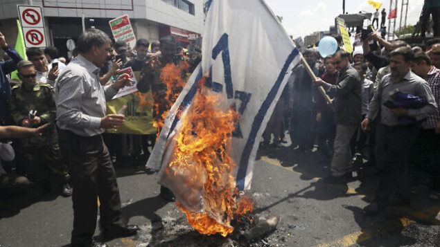 Iranian demonstrators burn a representation of the Israeli flag during their annual protest to mark Quds, or Jerusalem Day, in Tehran, Iran, Friday, May 31, 2019. Thousands of Iranians rallied Friday to mark Quds, or Jerusalem Day, which will see demonstrations across the Mideast as the Trump administration tries to offer an Israeli-Palestinian peace plan. (AP Photo/Vahid Salemi)