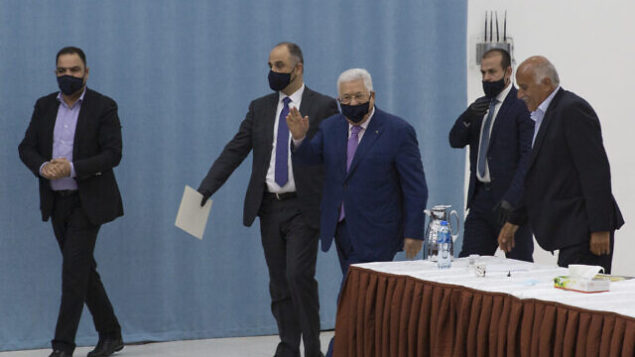 Palestinian President Mahmoud Abbas arrives to head the Palestinian leadership meeting at his headquarters, in the West Bank city of Ramallah, Tuesday, May 5, 2020. (AP Photo/Nasser Nasser, Pool)