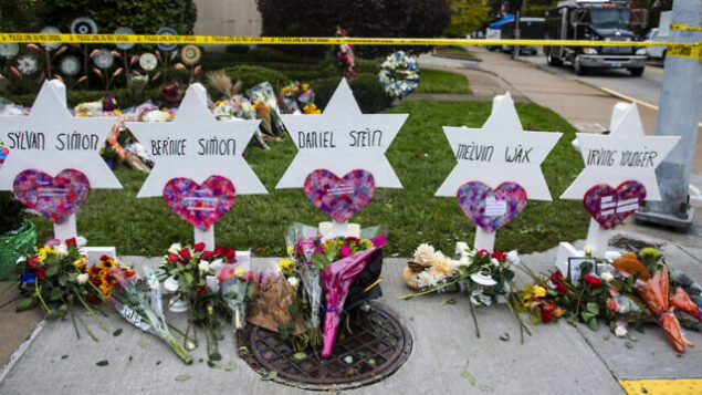 TREE OF LIFE SYNAGOGUE, PITTSBURGH, PENNSYLVANIA, UNITED STATES - 2018/10/29: Flowers and stones are placed on the memorials erected outside of the Tree of Life Synagogue in Squirrel Hill. Members of Pittsburgh and the Squirrel Hill community pay their respects at the memorial to the 11 victims of the Tree of Life Synagogue massacre perpetrated by suspect Robert Bowers on Saturday, October 27. (Photo by Matthew Hatcher/SOPA Images/LightRocket via Getty Images)