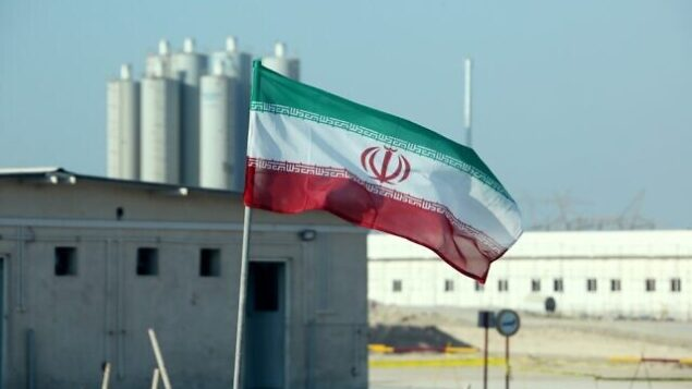 (FILES) In this file photo taken on November 10, 2019 an Iranian flag flutters in Iran's Bushehr nuclear power plant, during an official ceremony to kick-start works on a second reactor at the facility. - A magnitude 4.5 earthquake on Januray 8, 2020 rattled an area less than 50 kilometres (30 miles) from Iran's Bushehr nuclear power plant near the country's Gulf coast, a US monitor said. The quake, which had a depth of 10 kilometres, struck 17 kilometres south-southeast of Borazjan city at 6:49 am (0319 GMT), the US Geological Survey said on its website. State news agency IRNA said the earthquake was felt in Bushehr, site of the country's sole nuclear power plant. (Photo by ATTA KENARE / AFP)