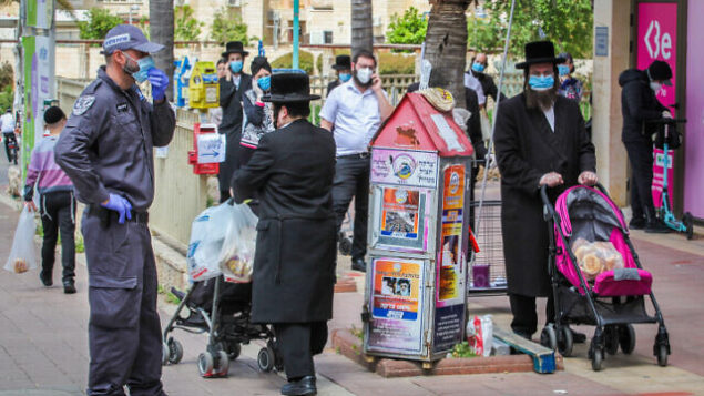 Ultra Orthodox Jews standing in line outside a supermarket in the central Israeli city of Elad, April 7, 2020. Photo by Yossi Aloni/Flash90 *** Local Caption *** ???? ??? ????? ?????? ????? ??? ???????