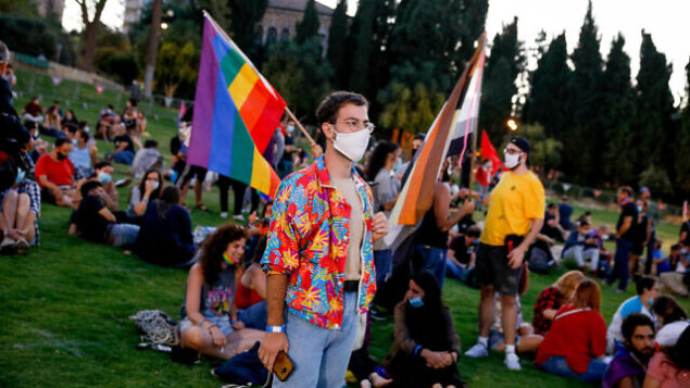 People take part in a rally to mark the annual Gay Pride Parade under restrictions following the spread of the coronavirus, in Jerusalem, on June 28, 2020. Photo by Olivier Fitoussi/Flash90 *** Local Caption *** מצעד הגאווה להטב אבטחה משטרה בידוק בטחוני