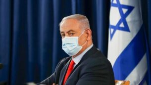 Israeli Prime Minister Benjamin Netanyahu, wearing a protective face mask, chairs the weekly cabinet meeting in Jerusalem on May 31, 2020. (Photo by RONEN ZVULUN / POOL / AFP)