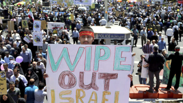 An Iranian protester holds an anti-Israeli placard during an annual anti-Israeli Al-Quds, Jerusalem, Day rally in Tehran, Iran, Friday, June 8, 2018. Iranians attended the rallies across the country to condemn Israeli occupation of Palestinian territories. (AP Photo/Ebrahim Noroozi)