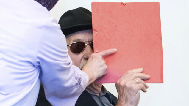 93-year-old former SS guard Bruno Dey in the concentration camp Stutthof near Danzig, arrives at the regional court in Hamburg, Germany, Monday, Oct. 21, 2019. The prosecution accuses the 93-year-old man of aiding and abetting the murder of 5230 people. (Daniel Bockwoldt/dpa via AP)