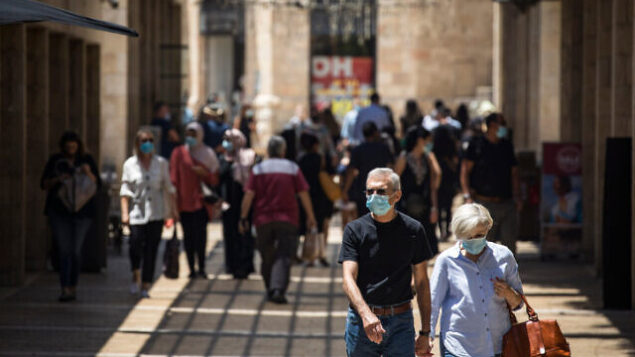 Jerusalemites wearing face masks for fear of coronavirus  walk and shop at the Mamilla mall near Jerusalem Old City on July 06, 2020. Israel has seen a spike of new COVID-19 cases bringing the authorities to reimpose restrictions to halt the spread of the virus. Photo by Olivier Fitoussi/Flash90   *** Local Caption *** ??????? ??????  ????? ????? ???? ????? ?????