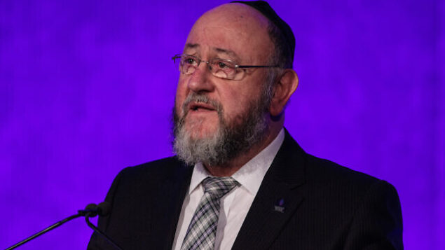 LONDON, ENGLAND - JANUARY 26: Chief Rabbi Ephraim Mirvis speaks at a National Holocaust Memorial Day event at the Queen Elizabeth II Conference Centre on January 26, 2017 in London, England. The commemorative event, attended by religious leaders, heard testimonies from survivors of the Holocaust, in which millions of predominantly Jewish people were killed. National Holocaust Day on February 27 marks the 72nd anniversary of the liberation of the Auschwitz concentration camp by Soviet troops. (Photo by Jack Taylor/Getty Images)