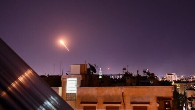 Syrian Air defences respond to Israeli missiles targeting south of the capital Damascus, on July 20, 2020. - Israeli strikes south of the Syrian capital wounded seven Syrian soldiers, state media reported, in an attack which a war monitor said hit several positions of regime forces and Iran-backed militias. (Photo by STR / AFP)