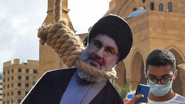 A picture shows noose with the portrait of Hassan Nasrallah, the head of Lebanon's Shiite Muslim movement Hezbollah, hung by Lebanese protesters in downtown Beirut on August 8, 2020, during a demonstration against a political leadership they blame for a monster explosion that killed more than 150 people and disfigured the capital Beirut. (Photo by - / AFP)