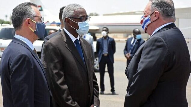 US Secretary of State Mike Pompeo (R) is welcomed by a Sudanese official in Khartoum on August 25, 2020. - Pompeo is on an official visit to Sudan to urge more Arab countries to normalise ties with Israel, following the US-brokered Israel-UAE agreement. He is the first American top diplomat to visit Sudan since Condoleezza Rice went in 2005. (Photo by - / AFP)