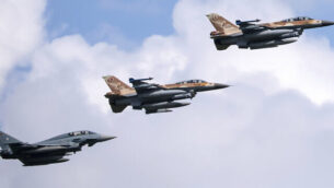A German air force Bundeswehr Eurofighter and an Israeli Air Force F-16 jets fly in formation over the Fuerstenfeldbruck airbase in commemoration of the 1972 Olympic Games assassination attempt in Fuerstenfeldbruck, Germany, Tuesday, Aug. 18, 2020. The attempt to rescue the hostages failed at the airbase in Fuerstenfeldbruck in 1972and the hostages perished. It is the Israeli Air Force's first time conducting joint air combat exercises in Germany. (Sven Hoppe/dpa via AP)