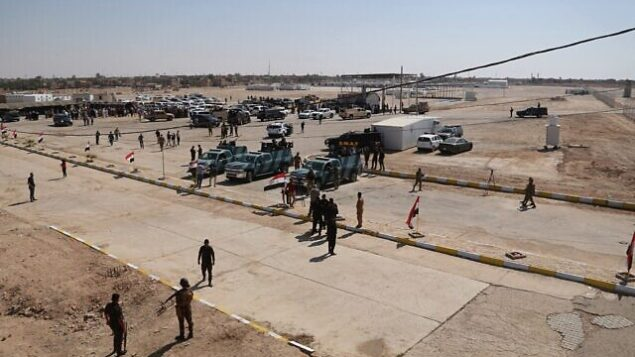 Iraqi security forces prepare to open the crossing between the Iraqi town of Qaim and Syria's Boukamal, in Qaim, Iraq, Monday, Sept. 30, 2019. Iraq and Syria opened Monday a key border crossing between the two neighboring countries, seven years after it was closed during Syria's civil war and the battle against the Islamic State group. (AP Photo/Hadi Mizban)