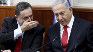 "Israeli Prime Minister Benjamin Netanyahu, right, listens to Foreign Minister Israel Katz during the weekly cabinet meeting at his office in Jerusalem, Sunday, Oct. 27, 2019.  Israel's prime minister says he wants a ""broad national unity government"" amid political deadlock over forming a government following last month's elections. Speaking to his Cabinet, Benjamin Netanyahu said such a coalition is essential for Israel to face what he said were mounting security challenges around the region. (Gali Tibbon/Pool Photo via AP)"