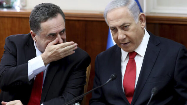 """Israeli Prime Minister Benjamin Netanyahu, right, listens to Foreign Minister Israel Katz during the weekly cabinet meeting at his office in Jerusalem, Sunday, Oct. 27, 2019.  Israel's prime minister says he wants a """"broad national unity government"""" amid political deadlock over forming a government following last month's elections. Speaking to his Cabinet, Benjamin Netanyahu said such a coalition is essential for Israel to face what he said were mounting security challenges around the region. (Gali Tibbon/Pool Photo via AP)"""