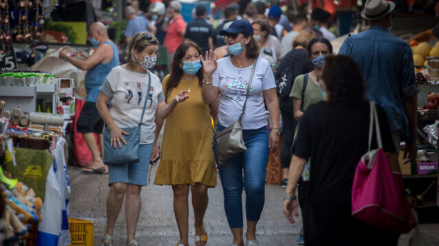 Israelis wear protective face masks as they shop for food at the Carmel market in Tel Aviv on August 05, 2020. Photo by Miriam Alster/FLASh90 *** Local Caption *** שוק הכרמל תל אביב קורונה קניות מסיכה מסיכות