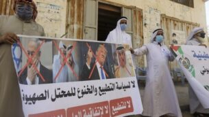Palestinian men carry the exed out portraits of the Bahraini King, US President and Israeli Premier during a protest in Deir al-Balah, in central Gaza Strip, on September 12, 2020, to condemn the normalisation of ties between Israeli and Bahrain. - The Palestinian cause has long cemented ties between Middle East nations with divergent interests, but amid shifting regional alliances they are increasingly isolated and in need of new friends, analysts say. In the latest blow, Bahrain broke ranks and agreed on Friday to open diplomatic ties with Israel, in a deal announced in Washington by President Donald Trump. (Photo by MAHMUD HAMS / AFP)