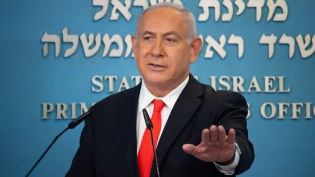 Israeli Prime Minister Benjamin Netanyahu gives a briefing on coronavirus developments in Israel at his office in Jerusalem, on September 13, 2020. - Israel's government announced  it would impose a three-week nationwide lockdown in an effort to stem one of the world's highest novel coronavirus infection rates after a surge in cases. (Photo by Yoav Dudkevitch / POOL / AFP)