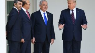 US President Donald Trump (R) with UAE Foreign Minister Abdullah bin Zayed Al-Nahyan (L), Bahrain Foreign Minister Abdullatif al-Zayani (2-L) and Israeli Prime Minister Benjamin Netanyahu (C) pose for pictures in the colonnade at the White House before the signing of the Abraham Accords where the countries of Bahrain and the United Arab Emirates recognize Israel, in Washington, DC, September 15, 2020. - Israeli Prime Minister Benjamin Netanyahu and the foreign ministers of Bahrain and the United Arab Emirates arrived September 15, 2020 at the White House to sign historic accords normalizing ties between the Jewish and Arab states. (Photo by SAUL LOEB / AFP)