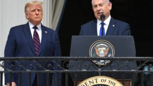 US President Donald Trump watches as Israeli Prime Minister Benjamin Netanyahu (R) speaks from the Truman Balcony at the White House during the signing ceremony of the Abraham Accords where the countries of Bahrain and the United Arab Emirates recognize Israel, on the South Lawn of the White House in Washington, DC, September 15, 2020. - Israeli Prime Minister Benjamin Netanyahu and the foreign ministers of Bahrain and the United Arab Emirates arrived September 15, 2020 at the White House to sign historic accords normalizing ties between the Jewish and Arab states. (Photo by SAUL LOEB / AFP)