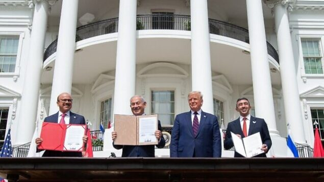 (L-R)Bahrain Foreign Minister Abdullatif al-Zayani, Israeli Prime Minister Benjamin Netanyahu, US President Donald Trump, and UAE Foreign Minister Abdullah bin Zayed Al-Nahyan hold up documents after participating in the signing of the Abraham Accords where the countries of Bahrain and the United Arab Emirates recognize Israel, at the White House in Washington, DC, September 15, 2020. - Israeli Prime Minister Benjamin Netanyahu and the foreign ministers of Bahrain and the United Arab Emirates arrived September 15, 2020 at the White House to sign historic accords normalizing ties between the Jewish and Arab states. (Photo by SAUL LOEB / AFP)