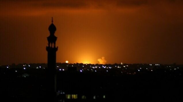Smoke and flames are seen following an Israeli air strike in the Khan Yunis town of the southern Gaza Strip on September 16, 2020. - Israel bombed sites in the Gaza Strip early Wednesday, Palestinian security sources said, after rocket fire from the Hamas-controlled territory into Israel the previous evening. The retaliatory attack came the morning after the United Arab Emirates and Bahrain signed a landmark accord in Washington establishing diplomatic relations with the Jewish state. (Photo by SAID KHATIB / AFP)