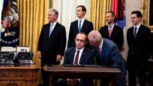 WASHINGTON, DC - SEPTEMBER 04: Prime Minister of Kosovo Avdullah Hoti sits at a desk as he attends a signing ceremony and meeting with U.S. President Donald Trump and the President of Serbia Aleksandar Vucic the in the Oval Office of the White House on September 4, 2020 in Washington, DC. The Trump administration is hosting the leaders to discuss furthering their economic relations.   Anna Moneymaker-Pool/Getty Images/AFP