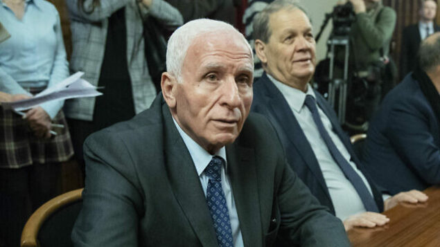 Fatah's official Azzam al-Ahmad, left, waits for a meeting with Russian Foreign Minister Sergei Lavrov and representatives of Palestinian groups and movements in Moscow, Russia, Tuesday, Feb. 12, 2019. (AP Photo/Pavel Golovkin, Pool)