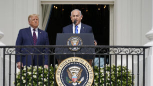 Israeli Prime Minister Benjamin Netanyahu speaks as President Donald Trump looks on, during the Abraham Accords signing ceremony on the South Lawn of the White House, Tuesday, Sept. 15, 2020, in Washington. (AP Photo/Alex Brandon)