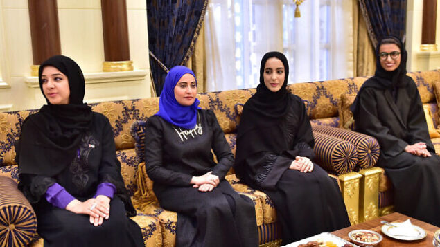 In this Feb. 14, 2016 image released by the Emirates News Agency, WAM, and made available today, from left to right, Reem Ibrahim Al Hashimi, UAE Minister of State for International Cooperation, Ohood Al Roumi appointed as Minister of State for Happiness, Shamma Al Mazrui appointed as Minister of State for Youth and Noura Al Kaabi, UAE Minister of State for FNC Affairs, take part at swearing-in ceremony for ministers in Abu Dhabi, United Arab Emirates. (WAM via AP)