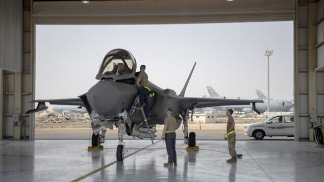 In this Aug. 5, 2019, photo released by the U.S. Air Force, an F-35 fighter jet pilot and crew prepare for a mission at Al-Dhafra Air Base in the United Arab Emirates. A U.S.-brokered deal that saw Israel and the United Arab Emirates begin to open diplomatic ties may end up with Abu Dhabi purchasing advanced American weaponry like the F-35, potentially upending both a longstanding Israeli military edge regionally and the balance of power with Iran. (Staff Sgt. Chris Thornbury/U.S. Air Force via AP)