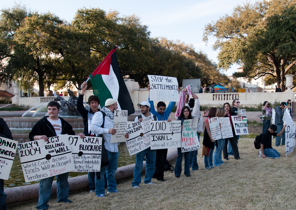 An illustrative photo of pro-Palestinian demonstrators during an Apartheid Week event at the University of Texas. (photo credit: CC-BY Monad86, Flickr)