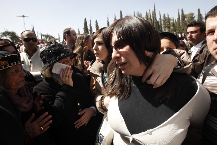 Eva Sandler arrives at the funeral of her family in Jerusalem. PM Netanyahu visited Sandler to pay his respects (photo credit: Miriam Alster/FLASH90)