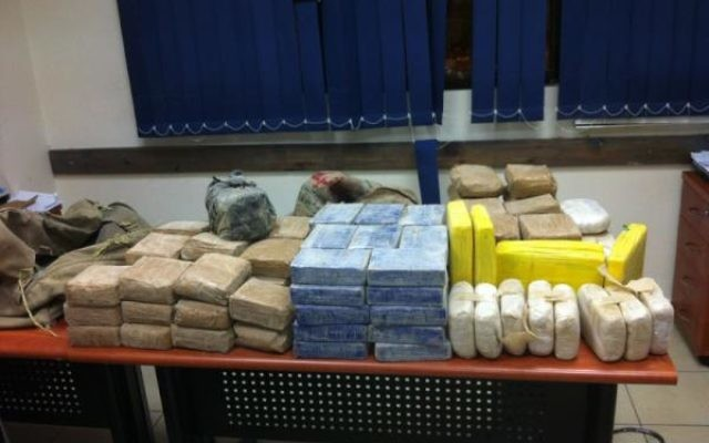 Part of a 63 kilogram stash of cocaine and heroin nabbed Tuesday night (photo credit: Israel Police Twitter feed)