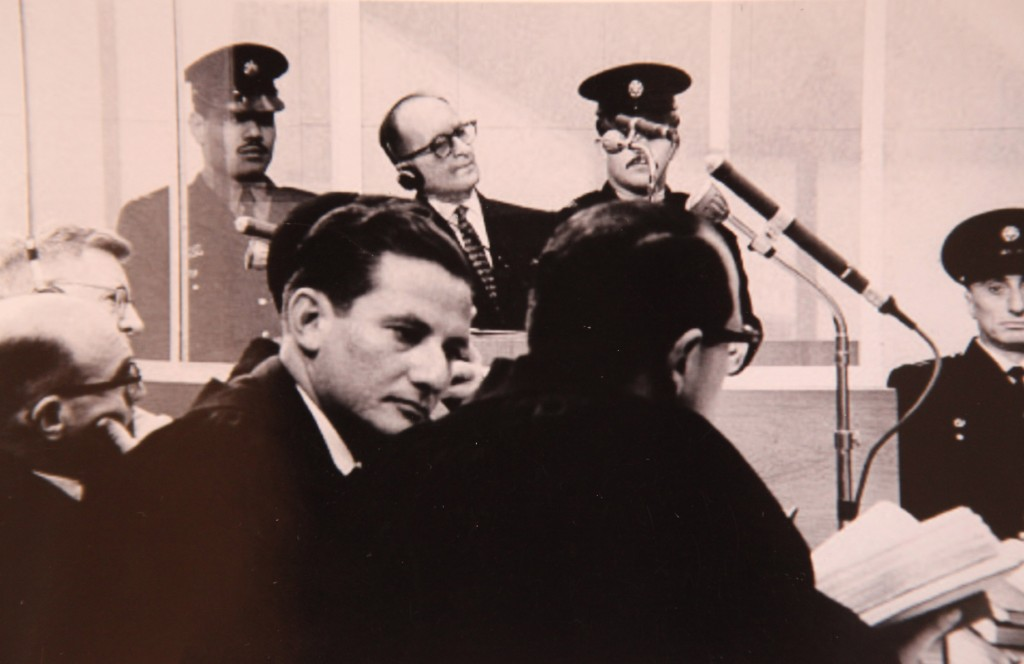 Chief prosecutor of the Eichmann trial, Israeli Attorney Gideon Hausner (left) and Justice Gabriel Bach, senior prosecutor in the Adolf Eichmann Trial (middle, facing camera), during Adolf Eichmann's (back) trial in Jerusalem (photo credit: GPO/Flash90)