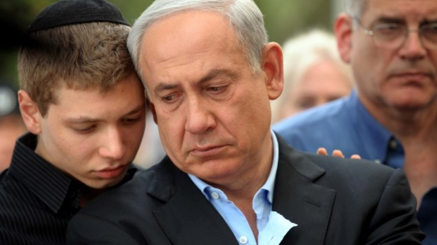 Prime Minister Benjamin Netanyahu with his son Yair at the funeral of Netanyahu's father, Benzion, in Jerusalem, on Monday. (photo credit: Avi Ohayon/GPO/Flash90)