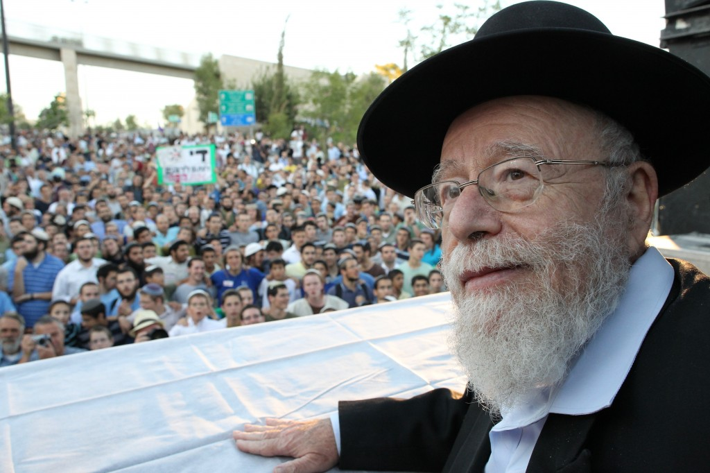 Rabbi Dov Lior, one of the defendants in the new legal action, speaks at a rally outside the Supreme Court in Jerusalem in July 2011 (photo credit: Nati Shohat/Flash90)