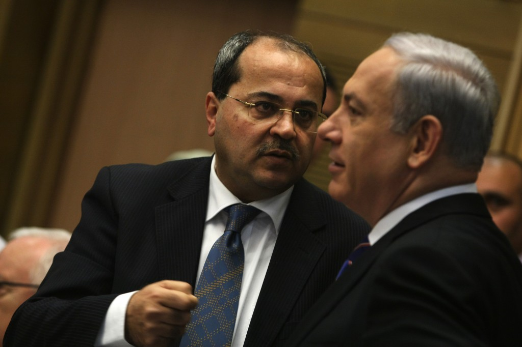 MK Ahmad Tibi speaks with prime minister Benjamin Netanyahu during a Knesset session (photo credit: Kobi Gideon/Flash90)