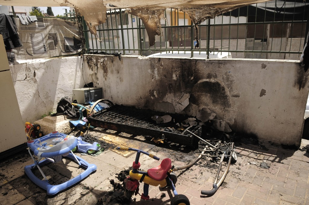 A courtyard in southern Tel Aviv damaged in a Molotov cocktail attack in April 2012.(photo credit: Tomer Neuberg/Flash90)