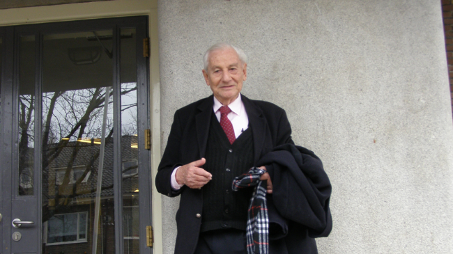 Justice Gabriel Bach, the prosecutor in the Adolf Eichmann trial, in front of the Vossius Gymnasium in Amsterdam. (photo credit: JTA/Cnaan Liphshiz)