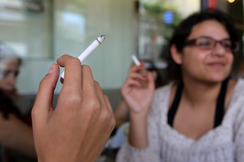 A woman smokes a cigarette on World No Tobacco Day in 2011 (photo credit: Nati Shohat/Flash90