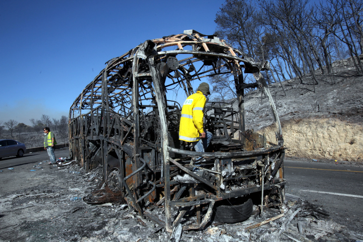 The burnt remains of a bus in which 38 Prison Service cadets were killed in the December 2010 Carmel forest fire (photo credit: Yossi Zamir/Flash 90)
