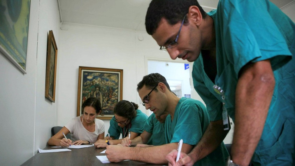 Doctors at Sheba hospital in Tel Hashomer (illustrative photo credit: Yehoshua Yosef/Flash90)