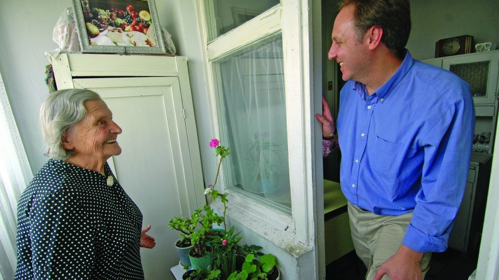 Claims Conference chief Greg Schneider visiting a Nazi victim at her home in Moldova. (Photo credit: Courtesy of Claims Conference/JTA)
