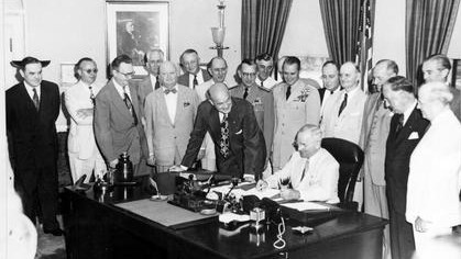 President Truman signing the National Security Act (photo credit: Wikimedia Commons)