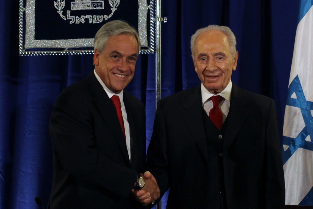 Chilean President Sebastian Pinera (left) meets his Israeli counterpart, Shimon Peres, in 2011, during a visit that preceded diplomatic tensions between the two countries. (Photo credit: Kobi Gideon/Flash90)